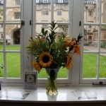Exeter College window with flowers